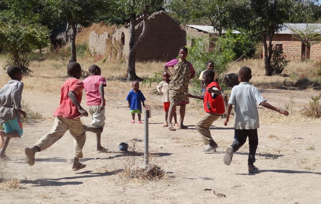Trading Footballs – Dusty Pitch Outside Mbeya